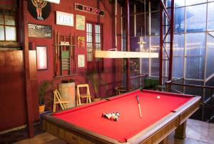 A pool table at Bunkie Hostel