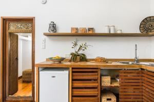 A kitchen or kitchenette at Bamboo Beach House