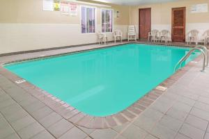 The swimming pool at or near Super 8 by Wyndham O'Fallon MO/St. Louis Area