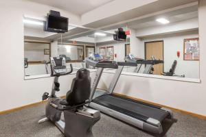 The fitness center and/or fitness facilities at Super 8 by Wyndham Monroe WI