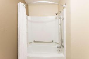 A bathroom at Super 8 by Wyndham Springfield East