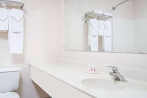 A bathroom at Super 8 by Wyndham Sheldon