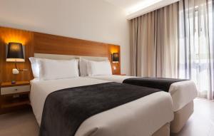 Cama o camas de una habitación en Hotel Mercure Lisboa