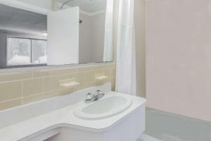 A bathroom at Super 8 by Wyndham W Yarmouth Hyannis/Cape Cod