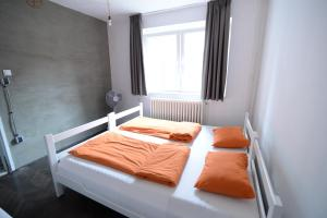 A bed or beds in a room at Hostel Fair and Square