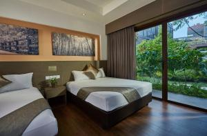 A bed or beds in a room at D'Resort @ Downtown East