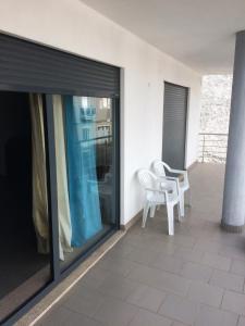 """A balcony or terrace at Apartamento """"Irmãos Vergueiro"""""""