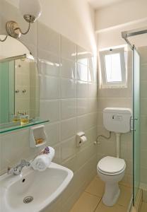A bathroom at Pelagia Aphrodite Hotel