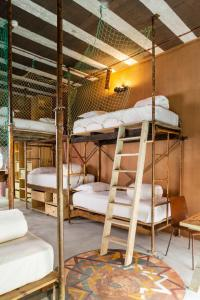 A bunk bed or bunk beds in a room at Noah Surf House Portugal