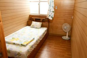 A bed or beds in a room at Emix Ishigaki