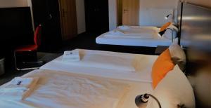 Ein Bett oder Betten in einem Zimmer der Unterkunft GS Hotel Mindelheim