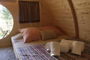 A bed or beds in a room at Camping Oleiros