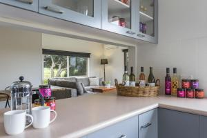 A kitchen or kitchenette at The Farm House by Green Olive at Red Hill