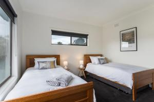 A bed or beds in a room at The Farm House by Green Olive at Red Hill