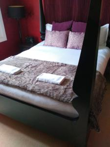 A bed or beds in a room at Peckham hill street