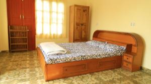 A bed or beds in a room at Dinesh House