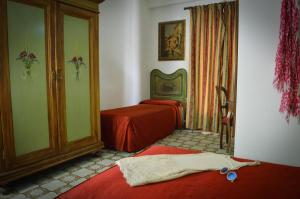 A bed or beds in a room at Hotel La Riva