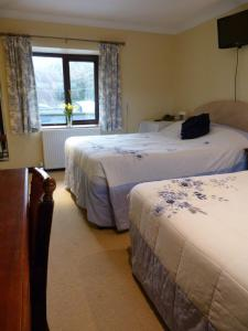 A bed or beds in a room at Cameley Lodge