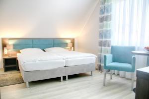 蘇爾埃施酒店房間的床