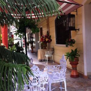 A restaurant or other place to eat at The Saint Joseph Residential Suites
