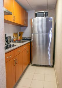 A kitchen or kitchenette at Modern Unique Space in San Juan- Great Location!!!
