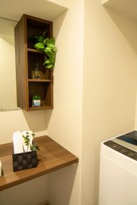 A kitchen or kitchenette at e-stay ebisu