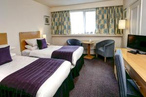 A bed or beds in a room at Best Western Frodsham Forest Hills Hotel