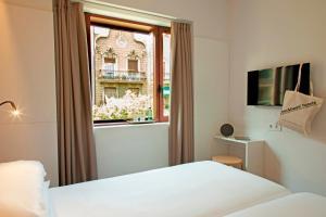 Кровать или кровати в номере Chic & Basic Velvet