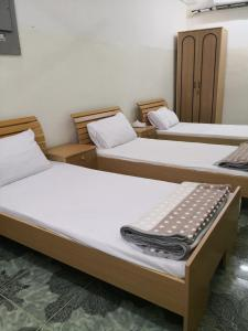 A bed or beds in a room at Al Naaman Bin Al Munther House