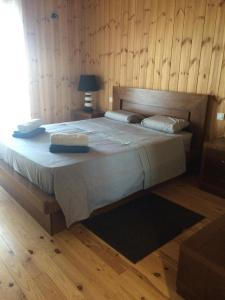 Ein Bett oder Betten in einem Zimmer der Unterkunft Villas Lidia
