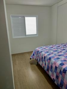 A bed or beds in a room at Botucatu Home Trade Center