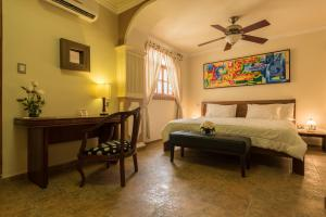 A bed or beds in a room at Hotel Casa Castel By GB Collection