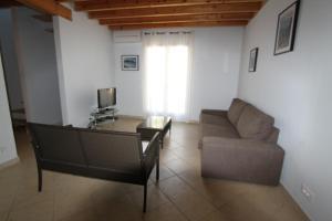 Ein Sitzbereich in der Unterkunft Villas Lidia