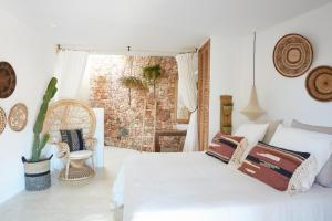 Ein Bett oder Betten in einem Zimmer der Unterkunft Can Tres Formentera