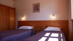 Un ou plusieurs lits dans un hébergement de l'établissement Hotel Du Parc - Manoir Du Baron Blanc