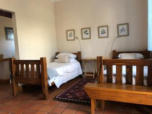 A bed or beds in a room at Homestay 24 Fonteinstreet