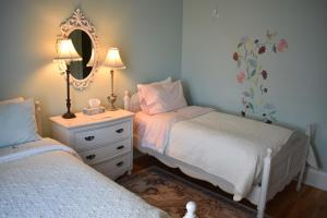 A bed or beds in a room at King George B&B