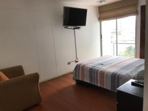 Cama o camas de una habitación en Apartamento Paracas