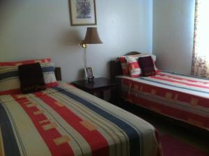 A bed or beds in a room at The Saint Joseph Residential Suites