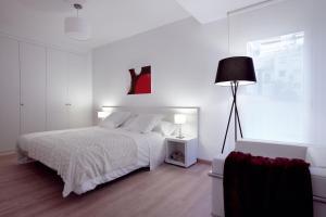 Un ou plusieurs lits dans un hébergement de l'établissement 08028 Apartments