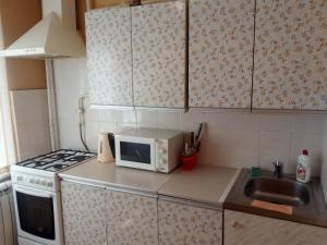 Кухня или мини-кухня в Apartament in center
