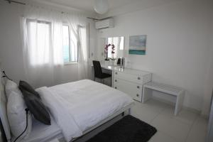 A bed or beds in a room at White Residence Luxury Apartments