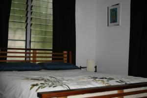 A bed or beds in a room at Saraswati's Oasis - Daintree Holiday Accommodation