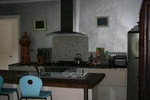 A kitchen or kitchenette at Saraswati's Oasis - Daintree Holiday Accommodation