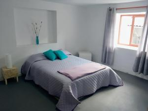 A bed or beds in a room at Casa I Love Huaraz