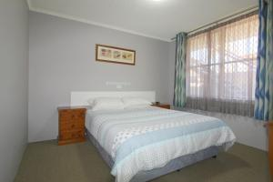 A bed or beds in a room at Beachfront 2, 25 Willow Street