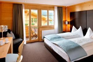 A bed or beds in a room at Aspen Alpine Lifestyle Hotel