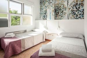 Letto o letti in una camera di Madrid Motion Hostels