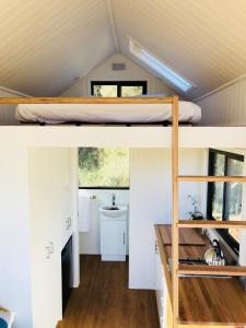 A kitchen or kitchenette at Charlotte Tiny House