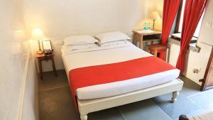 Un ou plusieurs lits dans un hébergement de l'établissement Madri Haveli